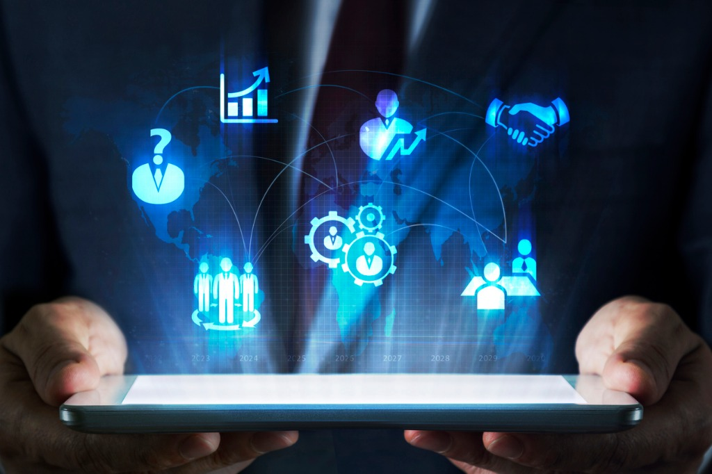 human-resources-concept-on-tablet-with-hologram-picture-id615087156